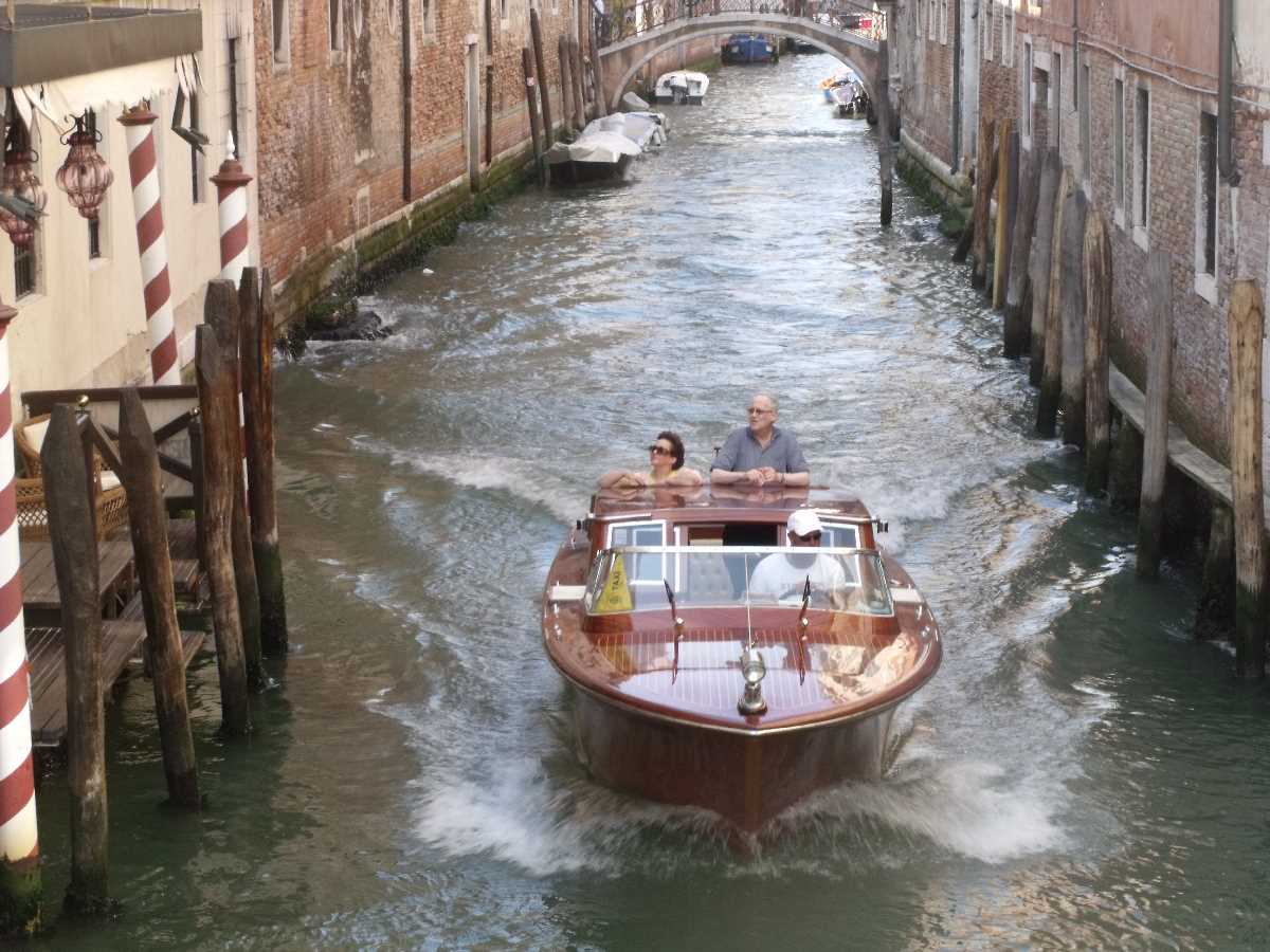Speedboat taxi on a canal in Venice